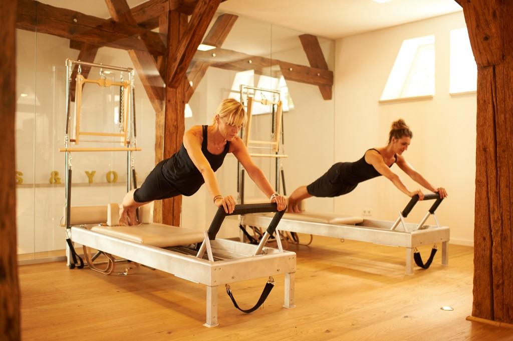 Übung Pilates Reformer